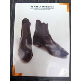 TOP HITS OF THE SIXTIES - thirteen of the biggest hitsof the 1960s arranged for piano/vocal. Complete with lyrics and guitar chords boxes. Wise publications