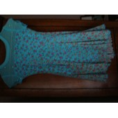 Tunique De Patinage Artistique Sagester Taille S Soit 10/12 Ans Forme Robe Fleurie � Fleurs Rose Et Jaunes Sur Fond Bleu Turquoise � Manches Courtes