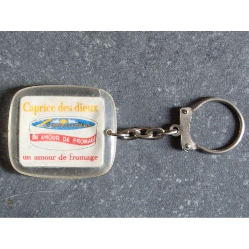 2afb986a0fd porte-cles-cle-clef-keyring-publicitaire-ancien-en-plastique-caprice-des-dieux-un-amour-de-fromage-serie- europe-belgique-939531130 L.jpg